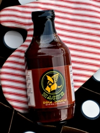 Buy a bottle of Hack's BBQ Sauce